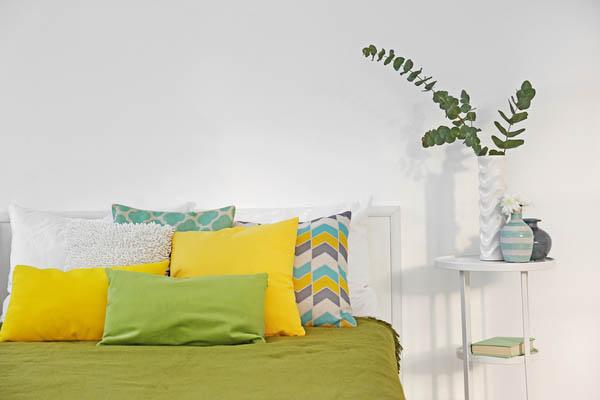 Add colourful Throw Pillows